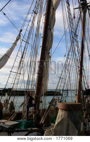 Man Adjusting Ropes On Sail Ship