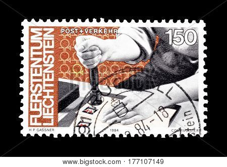 LIECHTENSTEIN - CIRCA 1984 : Cancelled postage stamp printed by Liechtenstein, that shows Postal worker.
