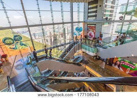Hong Kong, China - December 10, 2016: interior of Peak Tower shopping center, icon and landmark in Hong Kong. People on escalators go up to the Sky Terrace 428, the highest point of the island.