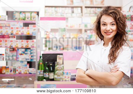 Smiling Pharmacist In Front Of Her Desk At Work