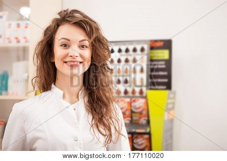 Smiling Happy Pharmacist In Front Of Her Desk At Work