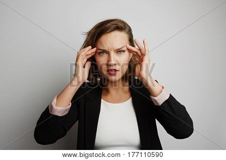 Portrait of young business woman made a mistake, studio photo isolated on a white background.
