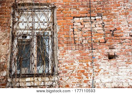 Window in an old house of red brick