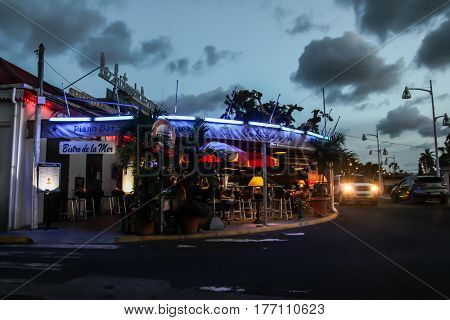MARIGOT, ST.MARTIN - JULY 31:  Evening atmosphere with lights from Bistro de la Mar and street in Marigot in July 31, 2015 in St.Maarten, Caribbean Island.