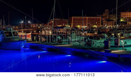 SANTA MARGHERITA LIGURE, ITALY - DECEMBER 2016: Night view on an illuminated port with moored boats at Santa Margherita Ligure, Italy