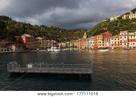PORTOFINO, ITALY - DECEMBER 2016: View on Porttofino town with color architecture, located between mountains in Italian Liguria, Italy