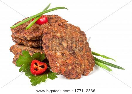 liver pancakes or cutlets with chili pepper parsley and green onions isolated on white background.