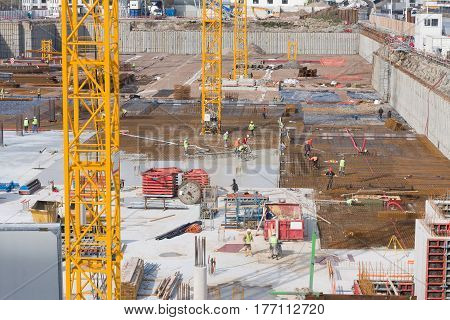 Large construction of the famous building and cranes
