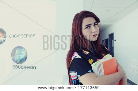 Pretty Young Girl With Long Beautiful Hair Study In University, She Is Holding Books