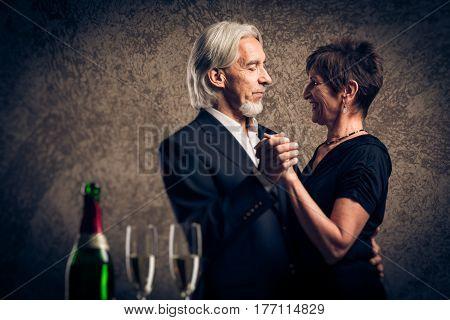 Studio shot of a senior married couple dancing