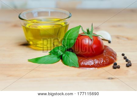Ketchup tomato basil olive oil herbs garlic board black pepper ingredients