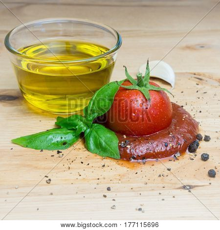 Ketchup tomato basil olive oil herbs garlic board black pepper ingredients square