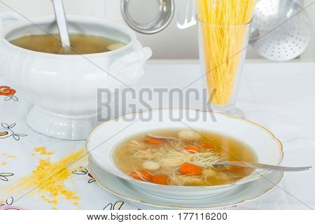 Homemade healthy chicken soup with chicken meat and vegetables
