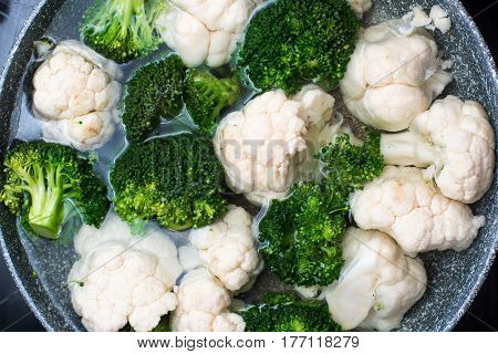 cooked broccoli and cauliflower in closeup raw