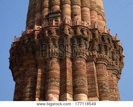 The Qutub Minar monument site details of architecture with masonry carvings in brick and sandstone.