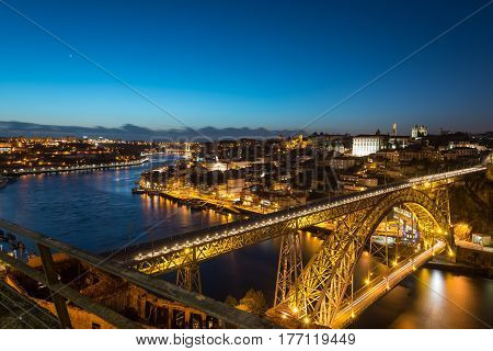 Aerial night view of Porto (Oporto),Duoro river and Dom Luis I Bridge from Mosteiro da Serra do Pilar