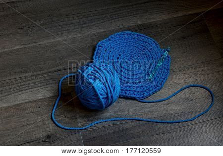 Blue crochet knitting manual pad on the table hand knitting