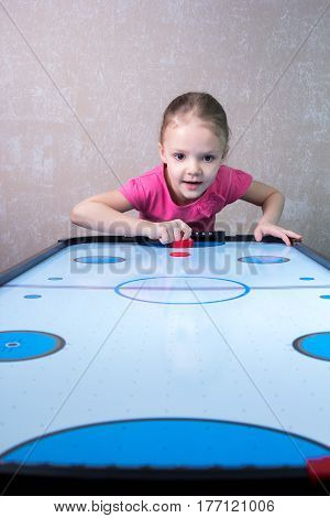 Little Girl Is Playing In Air Hockey