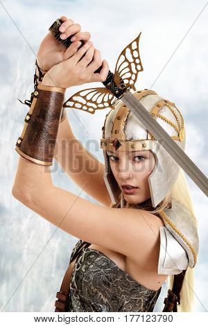 closeup woman warrior with sword with mountain in background