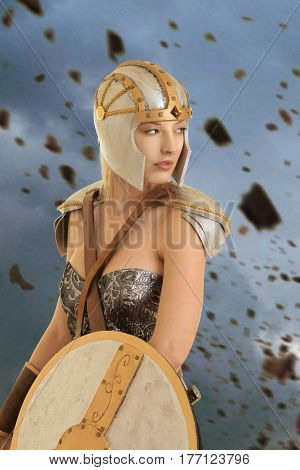 female warrior with helmet and shield looking at explosion of rocks