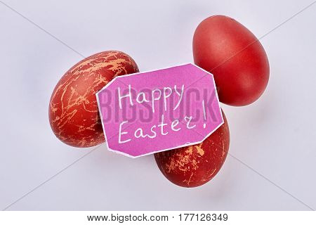 Painted eggs and greeting card. Greeting with Easter isolated.