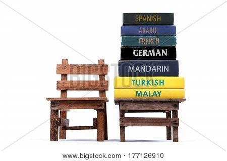 Dictionaries stacking on the table. Concept of learning languages. Copy space. White background.