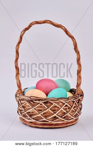 Basket with colored eggs isolated. Easter basket on white background. Get ready for Easter.