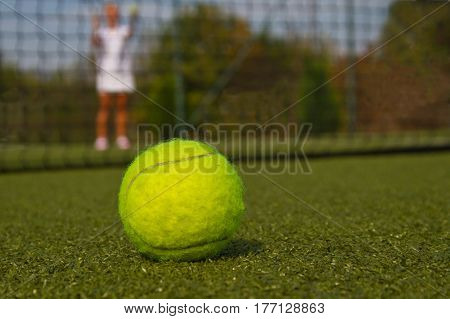 Tennis ball and silhouette of tennis player match