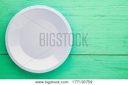 Plate On A Wooden Background. Blue Plate.plate Top View. Copy Space