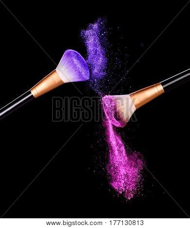 explosion of make-up powder isolate on black