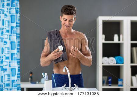 Health care, man in bathroom preparing dental floss