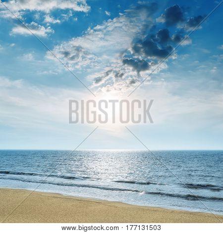 blue sky with low sun over sea