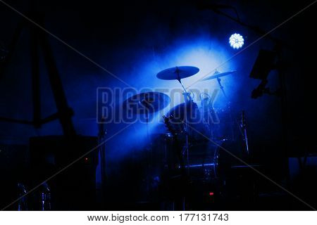 drum in a very dark room with smoke