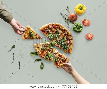 Hands taking slices of italian cuisine pizza