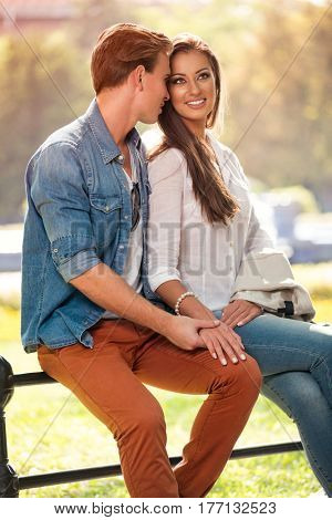 Beautiful girl with boyfriend on romantic date in park