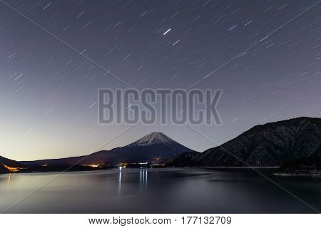 Lake Motosu and mt.Fuji at night time in winter season. Lake Motosu is the westernmost of the Fuji Five Lakes and located in southern Yamanashi Prefecture near Mount Fuji Japan