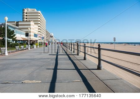 VIRGINIA BEACH, VIRGINIA - AUGUST 09, 2015: The Virginia Beach boardwalk, a popular tourist destination with oceanfront hotels, restaurants, attractions, and a fishing pier.