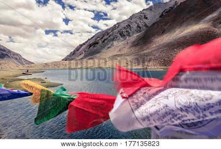 Buddhist flags waving in the wind over a small lake in Ladakh, Kashmir, India