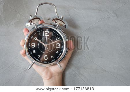 Woman Hand On Alarm Clock stock photo