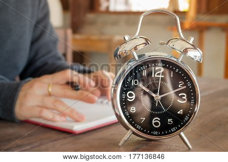 Alarm Clock On Wooden Work Table stock photo