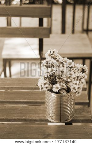 Vintage white flower pot on wooden table Old Style