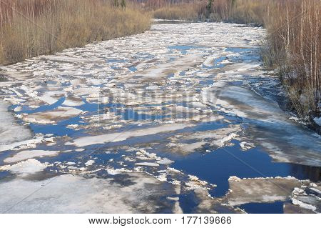 Spring landscape with drifting ice on the river
