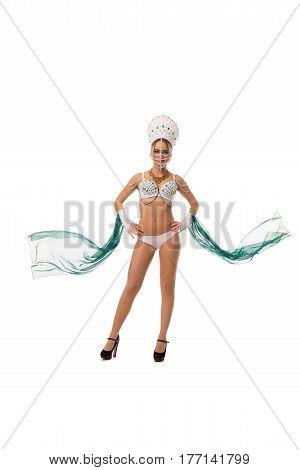 Pretty sexy brunette posing in russian kokoshnik, bead mask on her face, white underwear studio isolated portrait