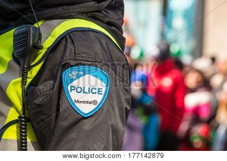 Montreal Canada - 19 March 2017: Close-up of a police patch with crowd n the background at St. Patrick's Day parade