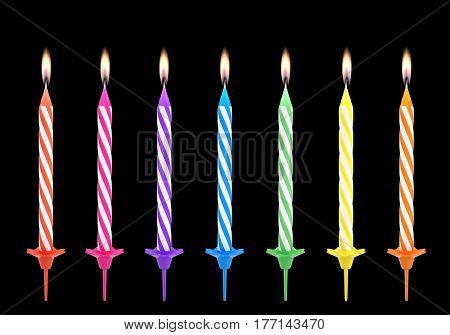 Multicolored birthdays candles isolated on black background - 3d render