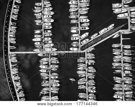 Looking Down At Moored Boats In Black And White