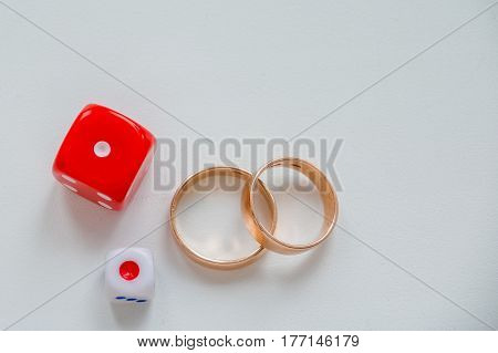 2 wedding ring together on white background . ring like a symbol of love. Family wedding rings. math and love. mathematical equation. love question. dice