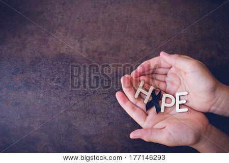 Hope Word With Black Ribbon On Hands, For Skin Cancer Awareness, Melanoma Awareness,narcolepsy Aware
