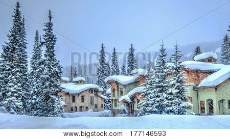 Ski resort on snowy day. Cozy village of Sun Peaks near Kamloops. British Columbia, Canada.