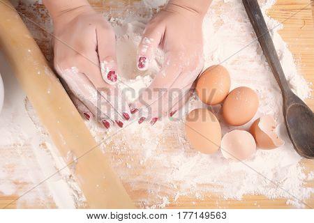 Woman Hands Knead Dough.